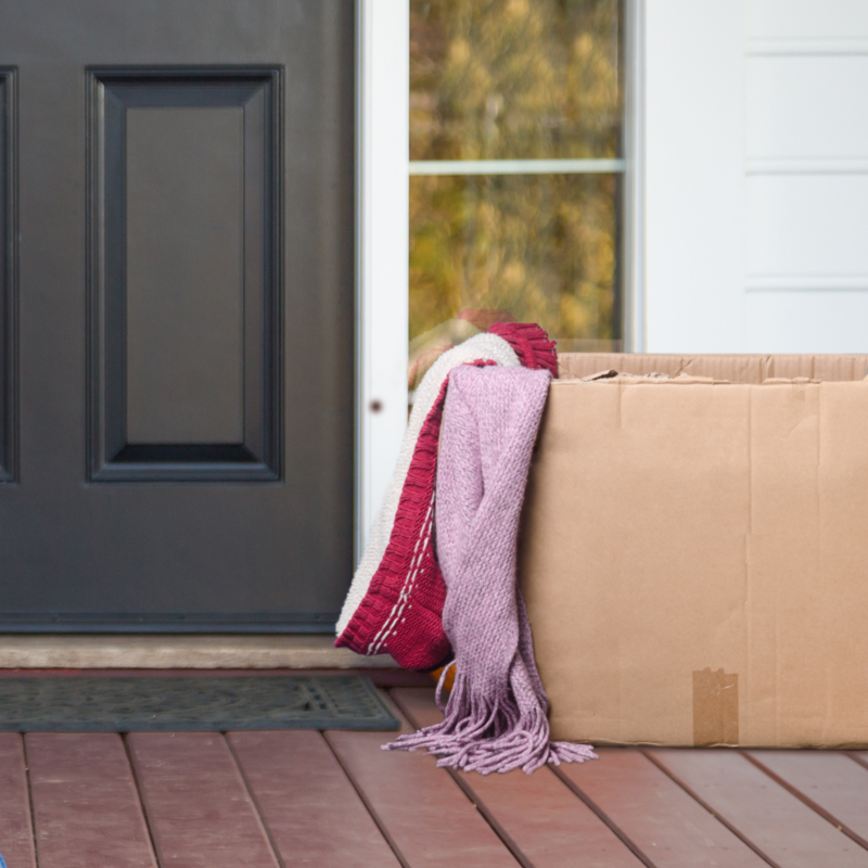 box with blankets on front porch