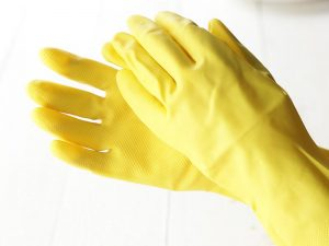 hands in yellow rubber gloves