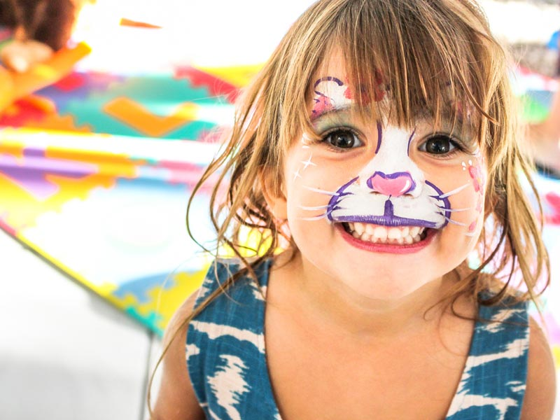 Ways to Help Shelters: Host a party, girl with face painted like cat